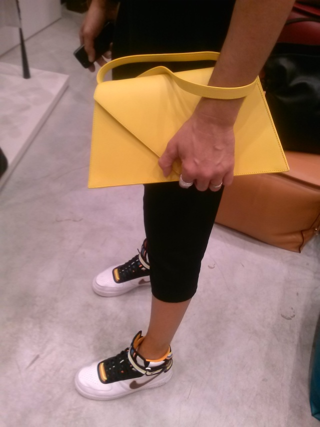LOEWE This fun, cheerful, lemon yellow clutch is the key accessory for all those grey, navy, brown, and black tones for A/W 2014